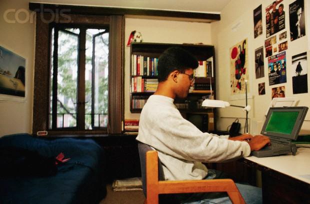 Harvard Student Working in His Dorm Room