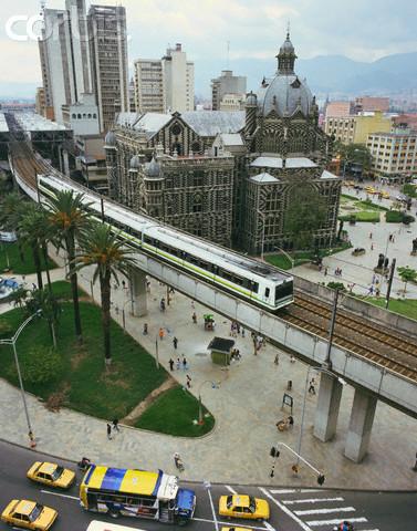 Metro Train Running Past El Palacio de la Cultura Rafael Uribe Uribe