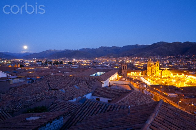Moon Rise Over The City Of Cusco At Dusk With Red Clay Half Round Roof Tops